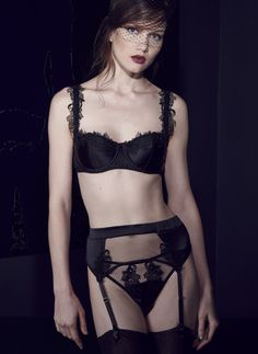 The After Dark padded balcony bra with intricate embroidery, fishnet  thong and suspender belt is the perfect designer lingerie set. Buy online now.