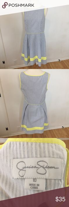 C61 Jessica Simpson Blue &White Striped Dress Fun, vintage style dress from Jessica Simpson. Blue and white vertical stripes with yellow trim on the bottom, neckline and sleeves. No signs of wear, like new. Size 10. Jessica Simpson Dresses Midi