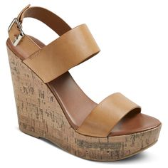 """Elevate your sandal game with our Mossimo Supply Co.® Women's Tracey Quarter Strap Sandals. Available in black or tan with a lofty, cork-finished 5"""" platform, these wedge-heeled wonders boast a sassy slingback heel with an adjustable side buckle and airy, open toe."""