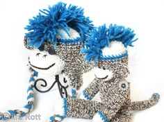 This listing is for 2 items  Handmade crochet sock monkey  Handmade crochet blue sock monkey hat with Mohawk for kids.    This sock monkey hat with funky Mohawk has the most authentic sock monkey look     This set make's a lovely baby shower gift, delivery gift or amazing photo props.  $ 80.00 CAD
