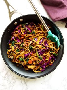Vegan Mongolian noodles and veggies stir fry in spicy soy ginger sauce makes a quick weeknight dinner . Ready under 15 minutes .No onion no garlic version.