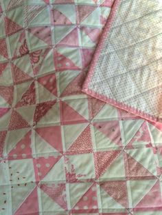 pink hourglass--like the straight line quilting as well--1/4 inch vertical and horizontal lines
