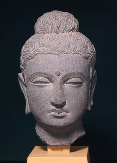 Buddha Head  Gandharan  Kushan period  about 3rd century A.D.  Object Place: Gandhara, Northwestern Pakistan  DIMENSIONS  Overall: 24.4 x 15.2 x 17.8 cm (9 5/8 x 6 x 7 in.)