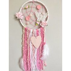 Make your little girls dreams come true, whilst catching the bad ones, with this one of a kind Webbed Tassel Dream Catcher. Fill their room with nothing but love, pleasant dreams and good vibes. Measurements: 6inch hoop/25-30cm tassel length These are unique made to order items and can