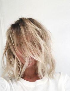 Wavy messy shoulder length blonde hair. Lob