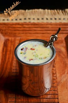 Masala paal recipe: A warm comforting drink warm milk spiked with spices and nuts,very delicious drink that also heals sore throat and induces good sleep,recipe @ http://cookclickndevour.com/2013/09/masala-milk-milk-with-spices.htmlasala paal recipe