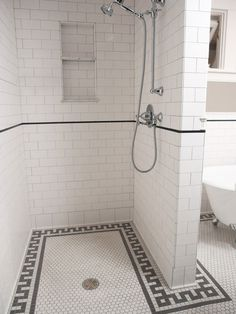 a really simple, clean way to do the shower in guest upstairs ensuite - repeating the half-wall concept..