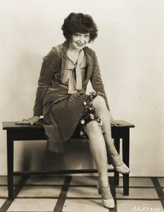 Even if my eyes are deceiving me, bloomers that end in fabric flowers could be great............................................... ....................................................................Clara Bow 1920's...