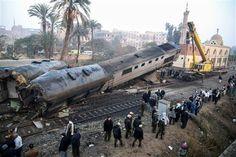 People gather at the site of a train derailment near Beni Suef, Egypt, Thursday, Feb. 11, 2016
