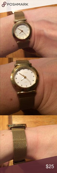 Skagen gold watch Skagen gold watch with diamond numbers. Needs new batteries Skagen Accessories Watches