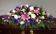 Double ended casket spray, enchanted garden. Blues, whites, purples and pinks. Roses, lilies, liatris, Iris, carnations.    CODE : CAS322