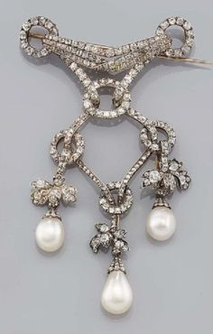 A natural pearl and diamond devant de corsage, mid 19th Century. Designed as a…