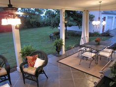 Drop cloth curtains on patio to help shield sun