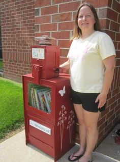 Librarian Amy Webb with the Little Free Library outside Sangamon School in Mahomet.