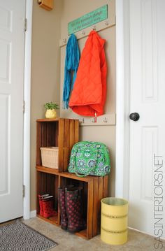 Get Organized! For an easy entry upgrade, add built-in coat hooks and wooden crates [easy do it yourself project] www.jennaburger.com