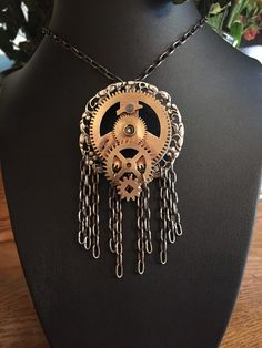 A personal favorite from my Etsy shop https://www.etsy.com/listing/292805353/steampunk-clock-gear-necklace-soldered