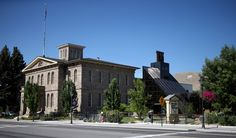 The #Nevada State Museum site of the original mint with the concourse in black glass, built to reflect the structure of the head-frames used for hoists in Nevada's early mines. #architecture #History