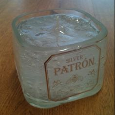 Patròn candle made out of an empty liquor bottle in Little Rock, AR. Recycle, repurpose, upcycle. Facebook.com/FHJLR