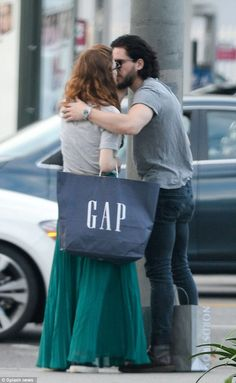 Going public! Game Of Thrones stars Kit Harington and Rose Leslie shared a kiss as they hi...