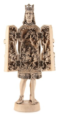 A FRENCH 19TH CENTURY CARVED IVORY TRIPTYCH FIGURE OF 'PRINCE PHILIPPE II'. Finely carved in full round, opening to reveal an intricately carved medieval battle scene. Inscribed 'PRISE de BOVVINES PHILIPPE II'.