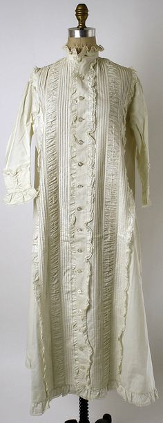 Nightgown, 1863, undetermined manufacturer, European or American, appears to be silk but may be polished cotton imitating silk, extensively decorated with lace, very nice cuffs, 17 buttons, full length ruched vertical bands on both sides, in storage at the Met.