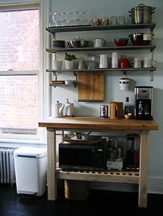 IKEA has a number of popular kitchen islands and carts — the OLOFSTORP, the STENSTORP, the FÖRHÖJA, the BEKVÄM — that are ideal picks for small kitchens. But my favorite may be the GROLAND. It's super sturdy, versatile, and good-looking, with a side rail feature that's just right for hanging pots, tools, or tea towels. Here are 10 examples that prove the GROLAND kitchen island is a smart, stylish choice for the budget kitchen.