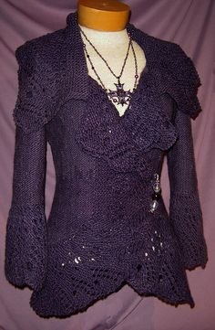 This romantically styled sweater jacket is a fine cover up for Fall and beyond.     It's lacy, antique look is a perfect counter point to the easy wrap styling and generous garter stitch collar. A drawstring at the back waist allows customized waist-shaping and smart 3/4 length sleeves make for easy wearing