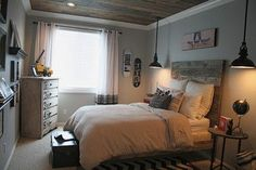Wall Paint : Behr Elephant Gray Ceiling : 1x8 pine wood (not flooring) stained and distressed and then attached to the rafters. low cost project, but time consuming. Bedding : Restoration Hardware, black geometric pillow from Etsy Headboard : 1x6 w/ mahogany stain and distressed It was really easy to build.