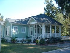 The Duke Street Cottage Plan by Allison Ramsey Architects built in Beaufort, South Carolina. This plan is 1053 Heated Square Feet, 3 Bedrooms and 2 Bathrooms. Carolina Inspirations, Book II, Page 67, C0406.