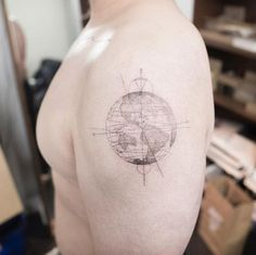 Faint globe tattoo by Hongdam