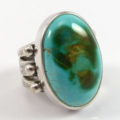 """Sterling Silver Ring with a Tufa Cast Split Band and set with Natural Royston Turquoise from Nevada. Ring Size: 5 .625"""" Width, 1"""" Height .375"""" - .5"""" Band Width"""