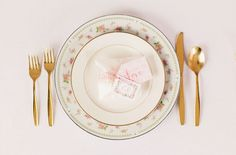 Vintage place setting with gold flatware