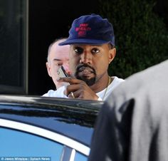On the road again: Kanye appeared to be chatting on his cell phone as he got into the car. He had two scheduled Saint Pablo Tour concerts in Chicago to do on Friday and Saturday nights