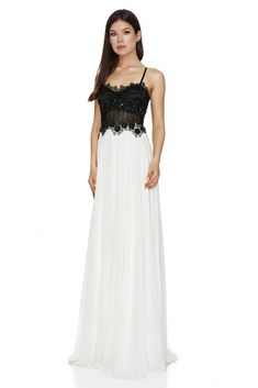 Make a stunning style statement in this fabulous full-length black and white long dress. The strapless and intricately decorated bodice has a transparent panel at the waist, hidden bra cups and is complimented by the contrasting gorgeous white full skirt. Black And White Long Dresses, Luxury Dress, Prom Dresses, Formal Dresses, Designer Gowns, Dress Making, Dresses Online, Bodice, Cups