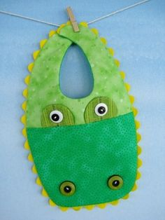 Gator Bibs, cute but I would replace the buttons with appliqué