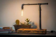 Pipe Lamp - An interesting piece of knotted wood and some recycled metal piping, can be used to create a unique, rustic styled desk lamp for your home or workplace. This is another great, eco-friendly invention using recyclable materials and a bit of good old fashioned ingenuity.