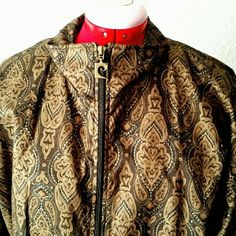"""90s Pierre Cardin Wind-Breaker Jacket This beautiful Pierre Cardin paisley jacket is wind and moisture resistant and fully lined. In excellent condition, was worn very little. Perfect for when you want to look like a million $$ and still be sporty! Colors are black, brown, and antique gold. Typical 90s style with elastic at hem and sleeve cuffs.  Size large, measures 45"""" bust; lower band 36"""" stretches to 44"""". Warm-up, starter jacket, track suit. Pierre Cardin Jackets & Coats"""