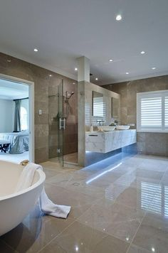 Bathroom: Lighting; Floor tiles; Spacious; Large windows; Large entry way