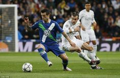Bale has to turn quickly and regain his balance in pursuit of Wolfsburg winger Vieirinha who looks to evade the Welshman's challenge Champions League Semi Finals, Sports Fanatics, Cristiano Ronaldo, Real Madrid, Comebacks, Challenge, The Incredibles, Football, Wolfsburg