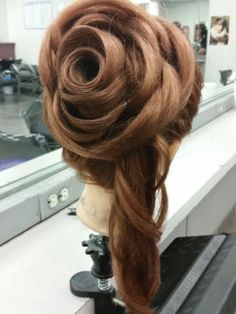 ROSE HAIRSTYLE done by students at our beauty school in North Austin!  Come in today to get your perfect look for any occasion.  For more pictures check out www.Facebook.com/BellaBeautyCollege
