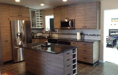 This IKEA Share Space fan uses SOFIELUND walnut effect light gray drawers and doors to create a custom modern kitchen.