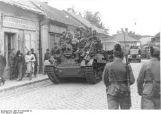 South-Eastern Front, August 1944 - Hungarian troops on tanks during the retreat from Romania to Hungary - Notice the two ladies on the left side of the picture turning to look at the tank; this is 1944 and they both wear pants, not exactly the average attire for young women in those days at some back of the beyond in Romania!