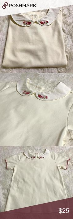 🎀 Janie And Jack Peter Pan Embroidered Top 🎀 Janie And Jack Peter Pan Embroidered Top  Girls: 8   Collar is white and the rest is a light cream. It has berry colored edging on the sleeves and the collar has embroidered flowers. It has 3 snap buttons in the back.  I paid $55 for this beauty that was only worn once.   # 289 Janie and Jack Shirts & Tops Blouses