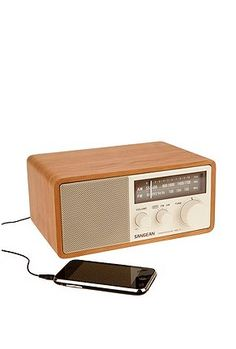 A sleek and stylish classic sound system with modern functionality and a rich wood case. AM/FM precision tuning; dynamic bass sound; aux-in socket and patch cable for you iPod, iPhone or mp3 player; headphone port; option for external FM antenna; detachable power cord. $139