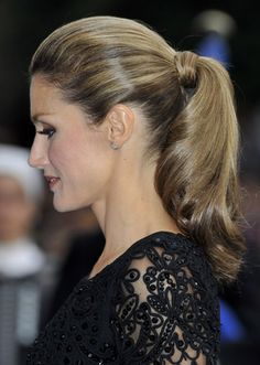 Sleek ponytail with curls as worn by Princess Letizia of Spain.