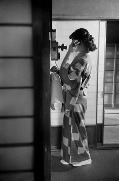 Werner Bischof 20 year old Jinuma Michiko, a fashion student, on the phone, Tokyo, Japan - 1951 Source : Magnum photos War Photography, Vintage Photography, Japan Art, Tokyo Japan, Japanese History, Student Fashion, Magnum Photos, Vintage Pictures, Vintage Japanese