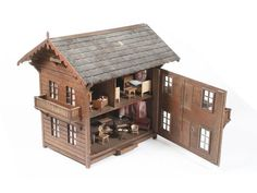 A 20th Century Swiss pine chalet dolls house with furniture