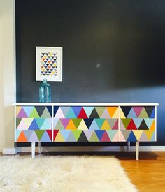 'Number 37' 1970s six drawer lowboy console. Casing and slimline legs in semi gloss white enamel. Tri Geometric pattern to drawer fronts hand painted and sealed. Drawers slide perfectly and are dressed with new black metal barrel knobs.