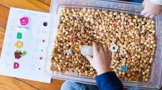 I Spy sensory bin with counting practice for preschoolers