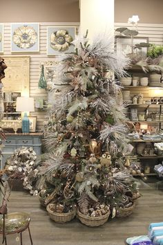 check out the baskets under the trees. Christmas Hearts, Cool Christmas Trees, Christmas Mantels, Christmas Design, Rustic Christmas, Xmas Tree, Christmas Projects, Beautiful Christmas, Christmas Tree Decorations